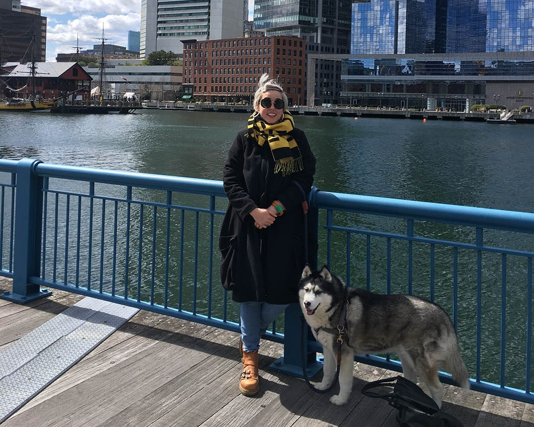 Photo of Marija and her dog on the Boston waterfront