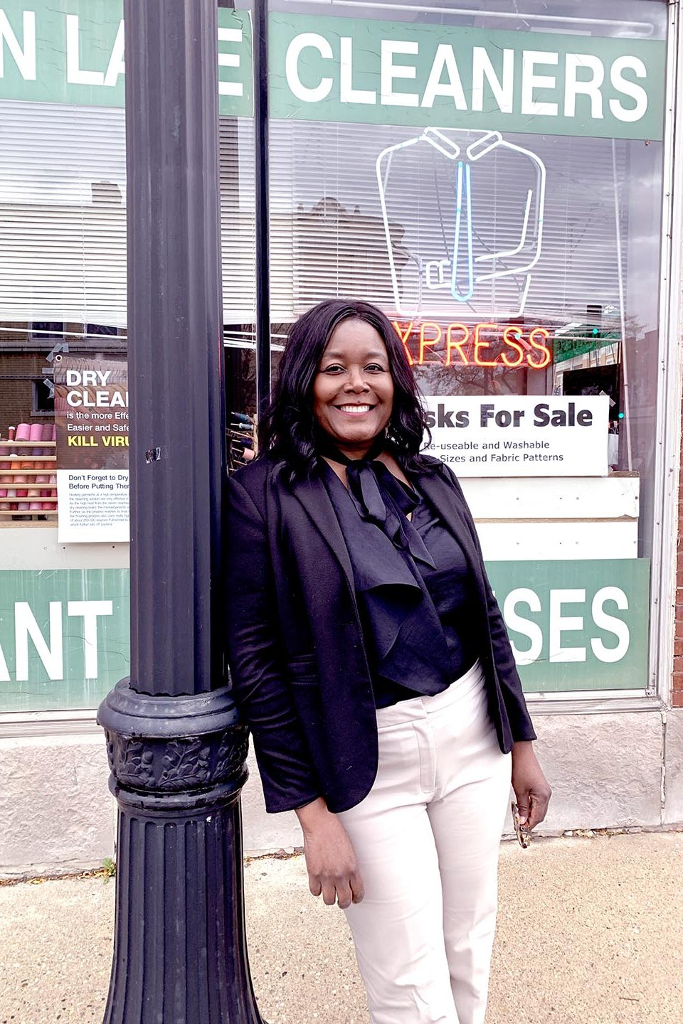 Photo of Maude in front of a store