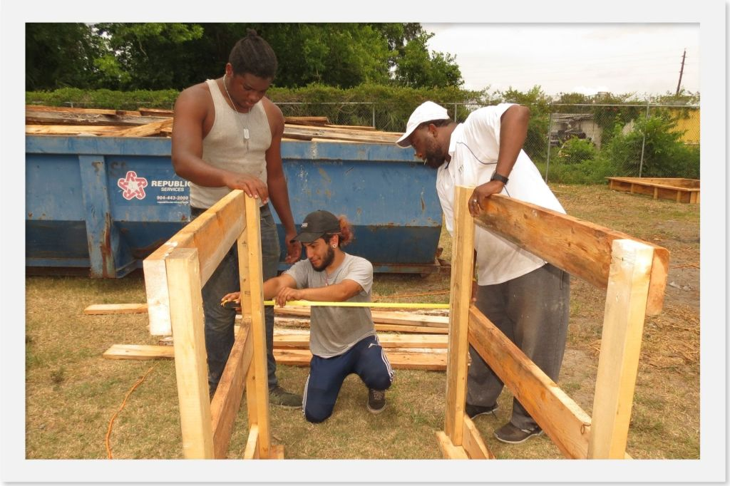 Young adults from The C.O.F.F.E.E. Project build a composting system