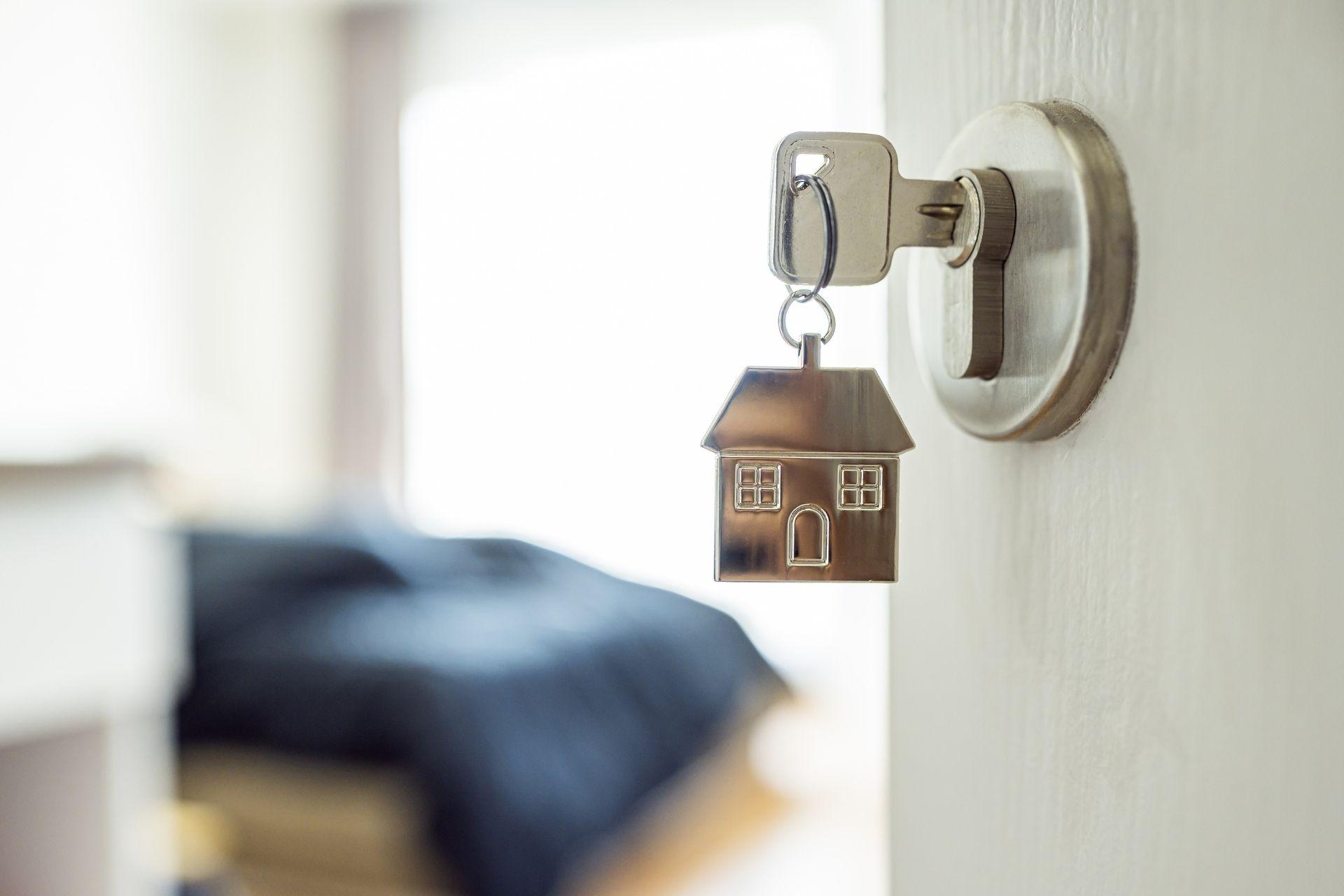 Open door with key in lock