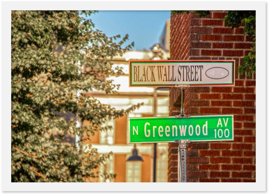 Signs pointing to Black Wall Street and N. Greenwood Ave in Tulsa, Okalahoma